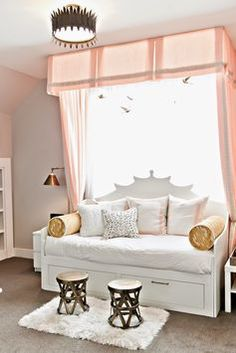 a teen bedroom in blush pink and white