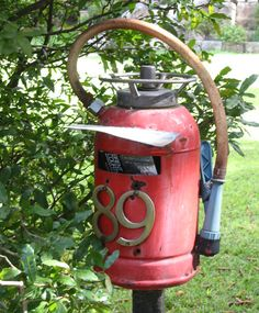 Mailbox made out of an old fire extinguisher ~ CooL!  :D