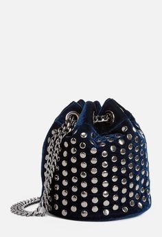 This glam and trendy bucket bag features a chain shoulder strap with a faux leather panel, stud detailing, and a magnetic snap closure....