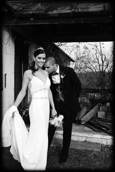 Black and White Wedding Photo of Groom Kissing Bride