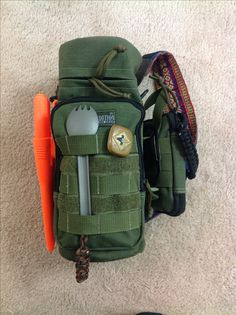 My Maxpedition 12 x 5 Bottle Holder and Mini Pocket Organizer EDC with Mora Bushcraft knife and Sea to Summit Spork attached...Got to love the spook!