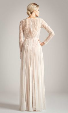 The Temperley London Long Christa Dress, from the Spring Summer 2014 collection, features an intricate embroidered and beaded signature tattoo design. With sheer long sleeves, a sheer back and a deep sheer V-neck, this elegant full-length dress is perfect for any occasion.