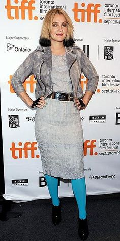 The first-time director keeps it quirky for the Toronto press conference for her film Whip It by adding teal tights and Perrin Paris fingerless gloves to her gray denim motorcycle jacket (from Hilary Duff`s Femme for DKNY JEANS collection!) and sheath – plus her bold new two-tone hairstyle.