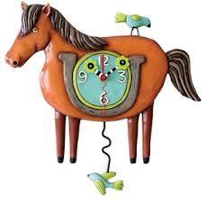 This horsey clock has a bird pendulum.