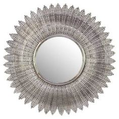 """A chic addition to your entryway or powder room, this lovely metal wall mirror showcases a sunburst-shaped silhouette and a textured finish.   Product: Wall mirrorConstruction Material: Metal and mirrored glassColor: Silver frame Dimensions:32"""" Diameter x 1.5"""" D"""