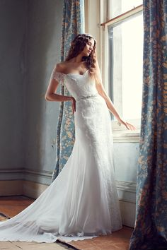 Bespoke Illusion gown with corded lace front detail, with silk georgette side and back panels. Bustier shape with lace sleeves finishing into back bodice
