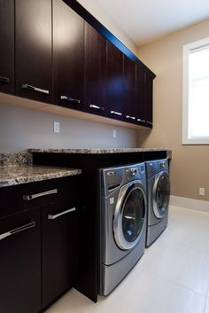 Granite laundry room - Bianco Antico granite laundry room with raised piece over washer & dryer. Eased edge profile.