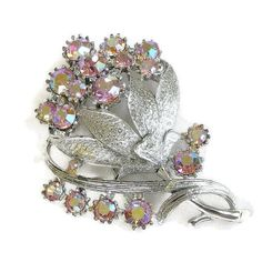 """This is a great Vintage Pink Aurora Borealis Rhinestone Flower Brooch signed CORO!   This brooch measures 2 3/8"""" high by 1 3/4"""" across –and oh such a lovely pastel pink flo... #teamlove #ecochic #vogueteam"""
