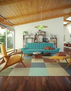 Mid century living room with a true-to era color palette: dark brown hardwood floors, honey tones, and teal upholstery.