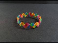 Origami Tutorial - How to fold a Paper Bracelet (Armband)  Begin with paper 1:4.
