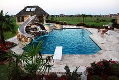 Travertine Geometric Pool with Rock Slide and Grotto traditional pool (Cool Pools With Slides) Swimming Pool Slides, Swimming Pools Backyard, Swimming Pool Designs, Pool With Slide, Lap Pools, Indoor Pools, Pool Decks, Backyard Pool Landscaping, Backyard Pool Designs