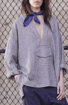 Pattern mixing at its finest with a neck scarf.