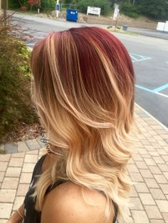 Cherry red to a peachy blonde balayage ombré. Check out more work at https://www.facebook.com/TaylorBlackfordBANG