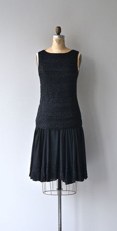 Vintage 1920s black silk dress with black beaded bodice and dropped waist, shallow V back, high, almost bateau neckline at the front and airy black