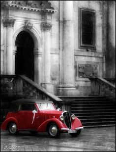 Get me to the church on time in this beautiful red vintage car!
