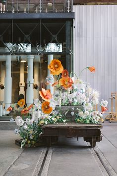 Installation of Enormous Orange and White Paper Flowers for a Modern Wedding Love Me Do Photography Unique Floral Design Inspiration for Spring Weddings! White Paper Flowers, Paper Flower Decor, Paper Flower Backdrop, Giant Paper Flowers, Flower Decorations, Wedding Decorations, Wedding Ideas, Wedding Photos, Poppy Flowers
