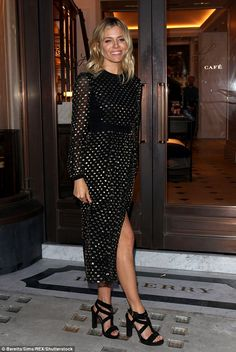 Blonde beauty: Sienna Miller, 34, looked typically chic in a black and gold dress as she hosted the launch of Wendy Rowe's Eat Beautiful book at Burberry's Thomas's Café in London, on Tuesday