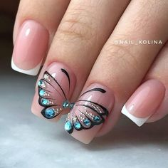 Nails Decorated with Butterflies