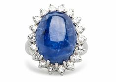 Derbyshire is a decadent vintage 1950's sapphire cocktail ring featuring an 18.58ct natural cabochon sapphire surrounded by a halo of diamonds. Amazing! TrumpetandHorn.com   $6,500