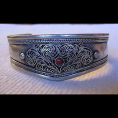 "G.SILVER CUFF FILIGREE TIBETAN CUFF NEPAL MADE Made of German Silver  In Silver Finish   Made In Nepal  Hand made by highly skilled artist in Nepal   Weight : 28 gm / 0.8  oz  1.1"" wide at the centre & Free Size Jewelry Bracelets"