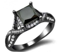 Black gold engagement ring. Love the square cut, and I would switch out the black diamond