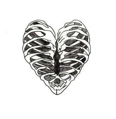 Perfect skeleton ribcage heart tattoo idea