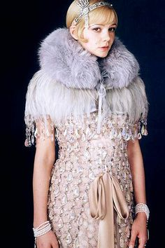 For The Great Gatsby, Catherine Martin worked with Miuccia Prada who designed 40 background dresses for party scenes as well as a show-stopping beaded frock worn with a fur collar by Carey Mulligan as Daisy Buchanan. To top it off, Daisy wears a headband with detachable brooch, made from diamonds and pearls by Tiffany & Co.