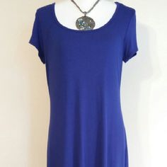 NWOT Summer short sleeve dress. Royal blue dress fitted at the waist. 38 inches long from shoulder to hem on form. 96% rayon and 4% spandex. Dresses Midi
