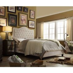 From its tufted upholstery to the curved silhouette, this lovely bed adds effortless style to your master suite or guest room.