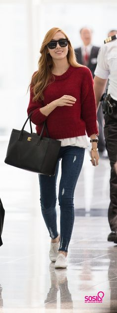 Jessica airport fashion: Red sweater layered over white top and ripped jeans