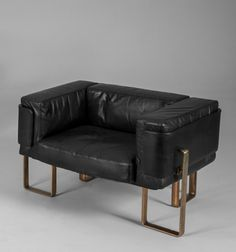 Esko Pajamies; Leather and Bronzed Metal Lounge Chairs for Asko, 1970s.