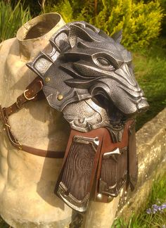 WolfShoulder by DragonArmoury wolf shoulder guard leather armor cosplay costume LARP LRP fashion clothes clothing equipment gear magic item | Create your own roleplaying game material w/ RPG Bard: www.rpgbard.com | Writing inspiration for Dungeons and Dragons DND D&D Pathfinder PFRPG Warhammer 40k Star Wars Shadowrun Call of Cthulhu Lord of the Rings LoTR + d20 fantasy science fiction scifi horror design | Not Trusty Sword art: click artwork for source