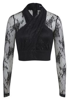 Take your party outfit to the next level with the Ivy Lace Top!Crafted in nylon this stunning top features a halter wrap front with keyhole cutout, fitted waistband, mesh sleeves with embroidered detail and back zip closure.Complete your outfit with a coordinating midi skirt.Model wears a size 10 and is 174cm tall.Fabric Content:100% NylonTrim: 62% Viscose, 33% Nylon, 5% ElastaneLining:100% Polyester
