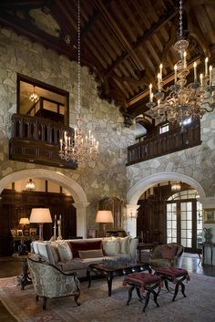 This is almost a perfect example of Jabobethan architecture, having stone walls (in the stead of terracotta brick walls), arched doorways, and upstairs balustrades open to below as well as the large crystal chandeliers and wood beamed ceiling; magnificent room!