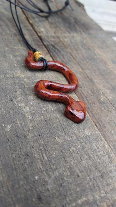 Hey, I found this really awesome Etsy listing at https://www.etsy.com/listing/554903672/snake-pendent-necklaces-exotic-wood