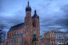 Took this photo outside today. It was raining and real cloudy. Photo of St. Mary Church in Krakow, Poland. Krakow Poland, Empire State Building, Saints, Mary, Places, Travel, Viajes, Destinations, Traveling