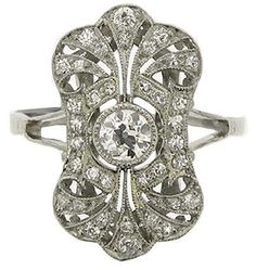 A Belle Époque old cut diamond cluster ring. The ring is platinum, with a stunning pierced openwork design and delicate split shoulders. The total diamond weight is is 0.85 carats. Via Diamonds in the Library.