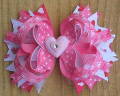VALENTINE'S DAY Hair Bow Boutique Style Pink White Red Heart Valentine Hair Bow with Sparkly Tulle and Heart Center. $8.99, via Etsy.