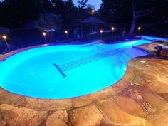 If you want a pool with personality, go for an unexpected shape. This unique pool by Emerald Pools and Spas, Inc. was created for a homeowner who plays and collects bass guitars. Photo courtesy of The Association of Pool & Spa Professionals