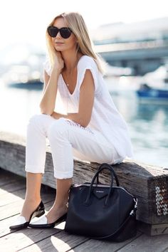 This combination of a white v-neck tee and white distressed slim jeans is perfect for off-duty occasions. Add monochrome leather loafers to your look for an instant style upgrade.   Shop this look on Lookastic: https://lookastic.com/women/looks/v-neck-t-shirt-skinny-jeans-loafers/18882   — White V-neck T-shirt  — White Ripped Skinny Jeans  — Black Leather Tote Bag  — White and Black Leather Loafers  — Black Sunglasses
