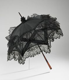 American parasol, ca. 1900.  metmuseum.org. I love the fancy construction of crisscrossing bands and the dotty lace.