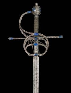 A COMPOSITE RAPIER INLAID WITH LAPIS - The blade circa 1600, the hilt 19th…