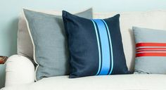 Create grain sack-inspired throw pillows with fun stripes to dress up your living room.