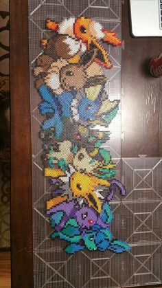 Eevee evolution -Pokemon perler beads by CustomPerlerBeadArt Pyssla Pokemon, Hama Beads Pokemon, Pokemon Craft, Diy Perler Beads, Perler Bead Art, Perler Bead Designs, Hama Beads Design, Pearler Bead Patterns, Perler Patterns