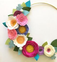 FELT FLOWER WREATH // Handmade to order out of wool blend felt with a 2 week turnaround time. This modern beauty is a fun take on a felt flower wreath. Wreath comes on a gold hoop base with 9 handmade felt flowers in shades of linen, cream, white, tangerine, cotton candy, fushia, orchid,