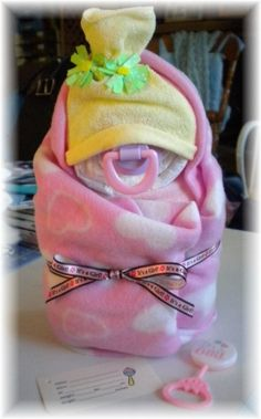 21. #Swaddle Me - 29 Diaper Cakes Any Mother Will Adore to #Receive ... → #Parenting [ more at http://parenting.allwomenstalk.com ]  #Mother #Cakes #Diaper #Cake #Ing