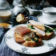 bkf = Batar open sandwiches topped with prosciutto, smoked chicken, sauteed spinach and Swiss cheese, lotus root white miso soup puree soup with rice cracker, fresh apple and Steuben grape and breakfast tea