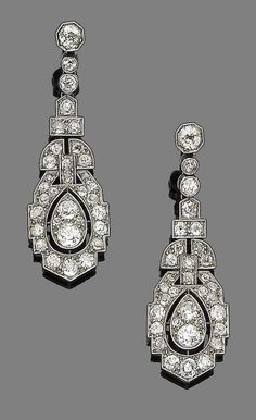 A pair of art deco diamond pendent earrings, circa 1920.  Each of tapering geometric design set throughout with old brilliant and single-cut diamonds, diamonds approx. 2.50cts total, length 4.2cm