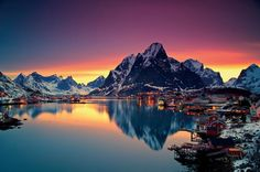 midnight-sun-in-lofoten-norway. Reine is a small Norwegian fishing village nestled in the Lofoten Archipelago, a picturesque string of islands within the Arctic Circle. Lofoten, Beautiful Norway, Beautiful World, Beautiful Places, Beautiful Sunset, Amazing Places, Amazing Photos, Beautiful Scenery, Wonderful Places
