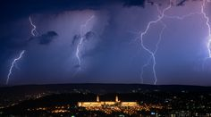 Image of South African union buildings with lightning in the background